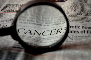 The word cancer in newspaper