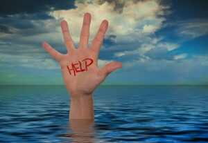 Covert Abuse - Hand Coming Out Of Water That Says Help