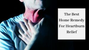 The Best Home Remedy For Heartburn Relief - Man Holding Inflamed Throat