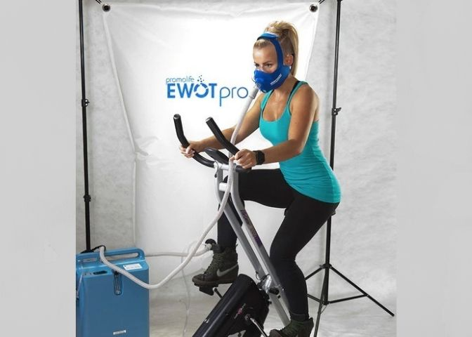 woman on bike breathing oxygen