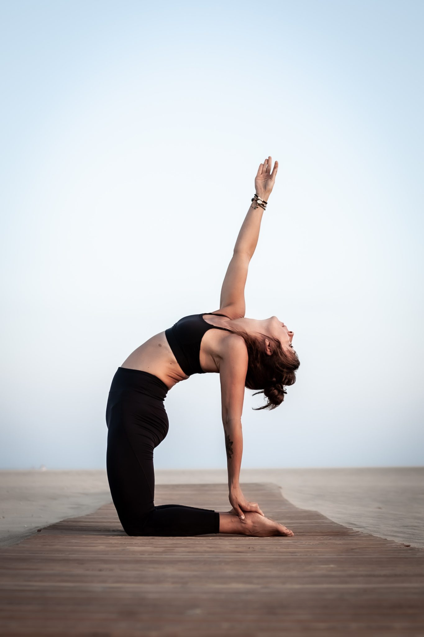 woman stretching with hand in air