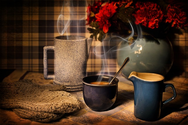 Coffee And Metabolism - Steaming Mugs Of Coffee